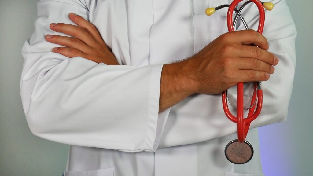 Medicare doctor holding stethoscope